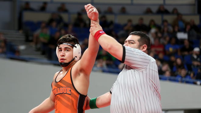 Sprague's Santos Cantu III is named the OSAA Wrestling Class 6A weight 195 champion at Veterans Memorial Coliseum in Portland on Saturday, Feb. 17, 2018.