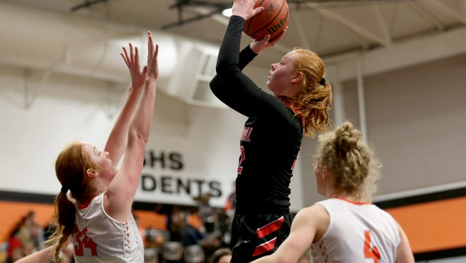 Central's Annika Riddell (22) shoots the ball over Silverton's Riley Traeger (34) and Ellie Schmitz (4) in the second half of the Central vs. Silverton girls basketball game at Silverton High School in Silverton on Tuesday, Feb. 20, 2018. Silverton won the game 55-46.