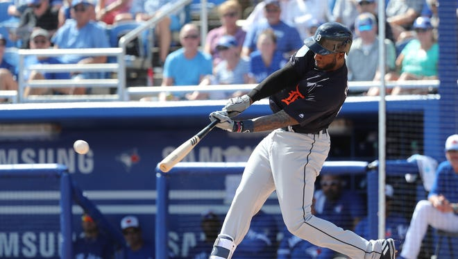 Feb 25, 2018; Dunedin, FL, USA; Detroit Tigers shortstop Niko Goodrum hits a single during the third inning against the Toronto Blue Jays at Florida Auto Exchange Stadium.