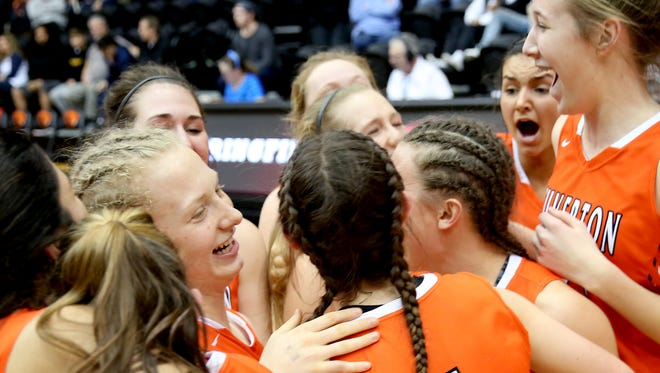 Silverton players celebrate their victory following the Silverton vs. Springfield OSAA Class 5A quarterfinal girls basketball game at Oregon State University in Corvallis on Tuesday, March 6, 2018. Silverton won the game 40-37 and will go on to play Marist Catholic on Thursday.