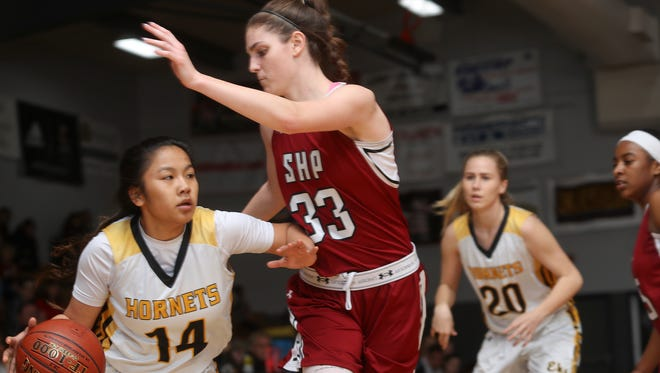 Enterprise's Natayah Saetern, left, tries to take the ball past Sacred Heart Prep's Tatum Angotti Saturday during the Hornets' 48-39 loss in Round 2 of the CIF State Girls Basketball Championships.