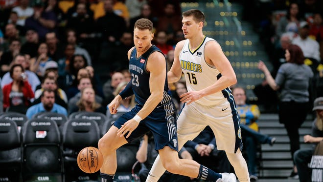 Nuggets center Nikola Jokic guards Pistons forward Blake Griffin in the first quarter at the Pepsi Center on Thursday.