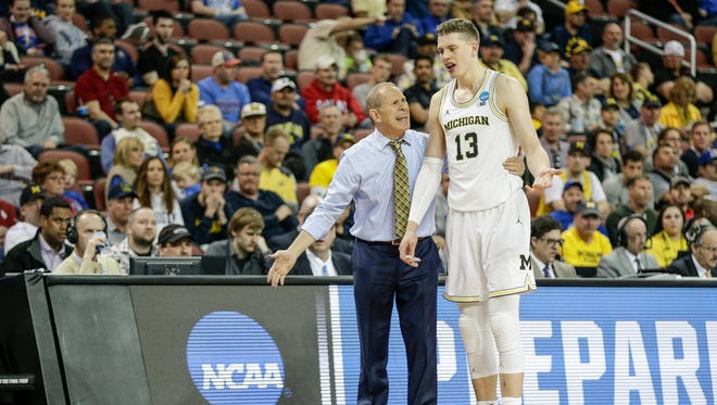 Michigan coach John Beilein talks to forward Moritz Wagner during the first round of the NCAA tournament at INTRUST Bank Arena in Wichita, Kan., Thursday, March 15, 2018.