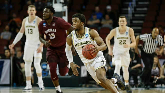 Michigan guard Zavier Simpson dribbles against Montana in the second half of the first round of the NCAA tournament at INTRUST Bank Arena in Wichita, Kan., Thursday, March 15, 2018.