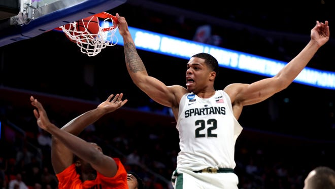Miles Bridges dunks against Bucknell in the second half at Little Caesars Arena on Friday.