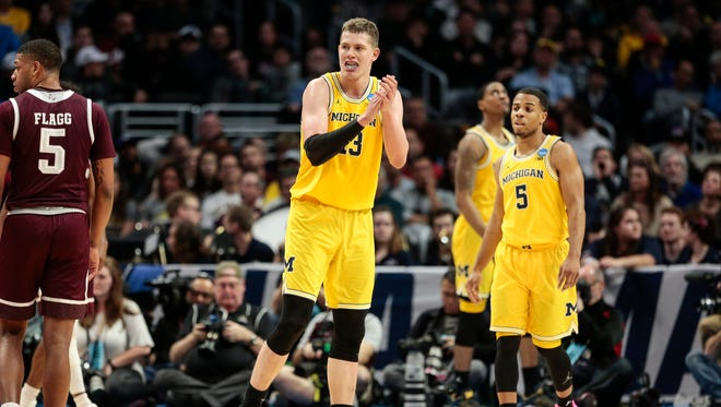 Moritz Wagner (13) celebrates a play during the second half of Michigan 's 99-72 win over Texas A&M in the Sweet 16 of the NCAA tournament in Los Angeles on Thursday, March 22, 2018.