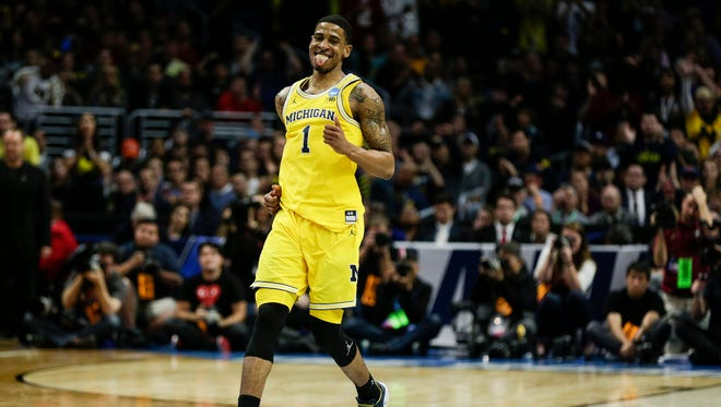 Michigan's Charles Matthews celebrates a play during the second half of the Elite Eight against Florida State in the NCAA tournament at Staples Center in Los Angeles, Saturday, March 24, 2018.