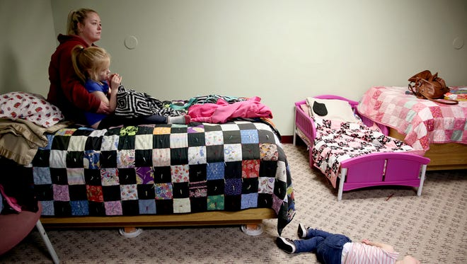 Kayla Talbott, 26, watches Toy Story with her daughters Jocelynn, 6, and Savannah, 3, in their room at Simonka Place in Keizer on Friday, March 23, 2018. Talbott, a single mom, has been at the shelter with her girls for about two months. She is working to earn her GED and start a new job in caregiving.