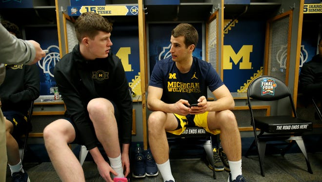 Michigan center Jon Teske (15)  and Austin Hatch chat in the locker room on Sunday, April 1, 2018, at the Alamodome in San Antonio.