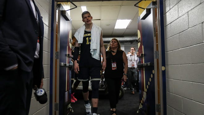 Michigan forward Moritz Wagner walks back in the locker room after the 79-62 loss to Villanova at the Alamodome in San Antonio, Monday, April 2, 2018.