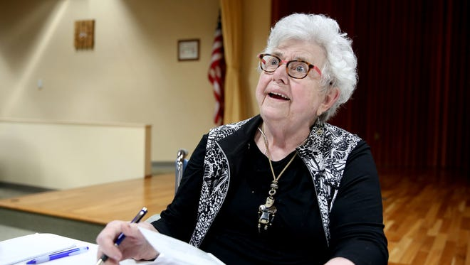 """Marilyn Callahan signs copies of her book, """"S.O. Ñ The New Scarlet Letters"""", at Capital Manor in West Salem on Wednesday, April 4, 2018."""