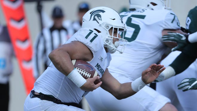 Michigan State running back Connor Heyward runs the ball during the annual spring game Saturday, April 7, 2018 at Spartan Stadium.