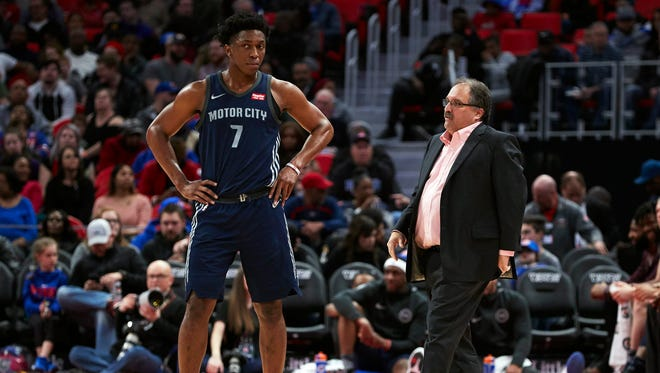 Stan Van Gundy, right, talks to Stanley Johnson during the second half against the Raptors at Little Caesars Arena on Monday.