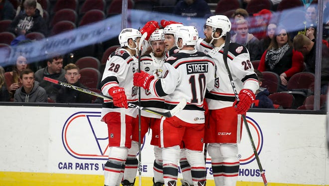 The Grand Rapids Griffins begin defense of their Calder Cup championship on Saturday.