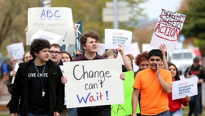 Hayden Hemeon, from left, Alyx Hall, and Geovanny Tolentino, all Sprague seniors, protest with students from several local schools for stricter gun legislation and safe schools during the March for Our Lives, part of a national movement, at the Oregon State Capitol in Salem on Friday, April 20, 2018.