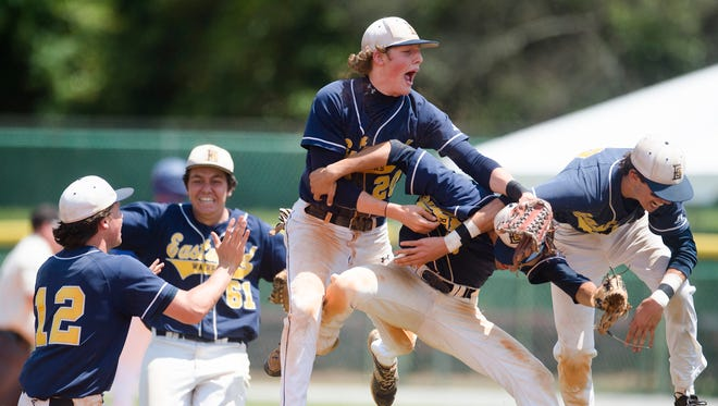 Eastwood's Morris Carmichael (20) and Benjamin Johnson (5) celebrate after winning the second and final game in the AISA Class A State Championship baseball series between Chambers and Eastwood on Tuesday, May 8, 2018.