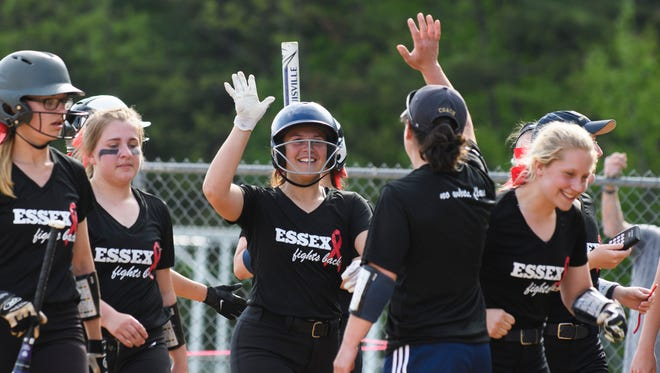 Sara Knickerbocker (17) celebrates a home run with head coach Ashley Stebbins during the girls softball game between North Country and Essex at Essex High School on Wednesday afternoon May 23, 2018.