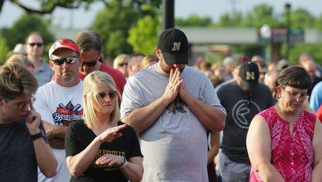 Community members pray together during a prayer vigil held at Federal Hill Commons in Noblesville in response to a shooting at Noblesville West Middle School, Saturday, May 26, 2018.