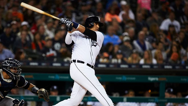 Victor Martinez hits an RBI double in the seventh inning against the Yankees at Comerica Park on Monday night.