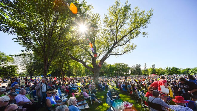 A large crowd relaxed in the grass to watch the live music Wednesday, June 13, for the first Summertime by George! event of the season at Lake George in St. Cloud.