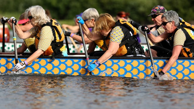 Teams compete in the Dragon Boat Races, part of the the World Beat Festival, on the Willamette River at Riverfront Park in Salem on Saturday, June 30, 2018.