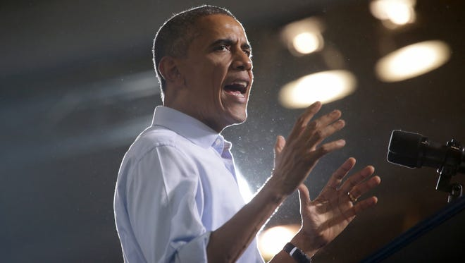 President Barack Obama speaks at the Democratic campaign rally to stump for Democratic candidates at Wayne State University in Detroit on Saturday, Nov. 1, 2014.