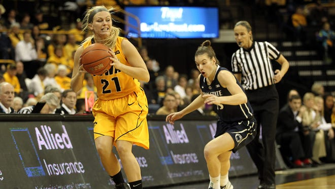 Iowa's Melissa Dixon struggles to keep the ball inbounds during the Hawkeyes' game against Penn State at Carver-Hawkeye Arena on Jan. 5. Iowa split their series with the Nittany Lions last year, with both road teams winning. The Hawkeyes begin their 18-game Big Ten schedule Sunday against Penn State.