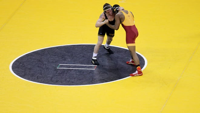 Carver-Hawkeye Arena will feature four quarterfinals going on at once on Saturday: Iowa-Chattanooga, Minnesota-Cornell, Ohio State-Lehigh and Missouri-Illinois.