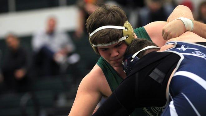 West High's Blake Moser wrestles Cedar Rapids Xavier's Mike Maher at 285 pounds on Thursday, Dec. 4, 2014. David Scrivner / Iowa City Press-Citizen