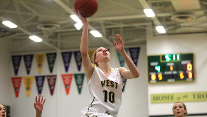 West High's Ali Tauchen shoots a lay-up during the Women of Troy's game against Dubuque Hempstead on Friday, Dec. 5, 2014. David Scrivner / Iowa City Press-Citizen