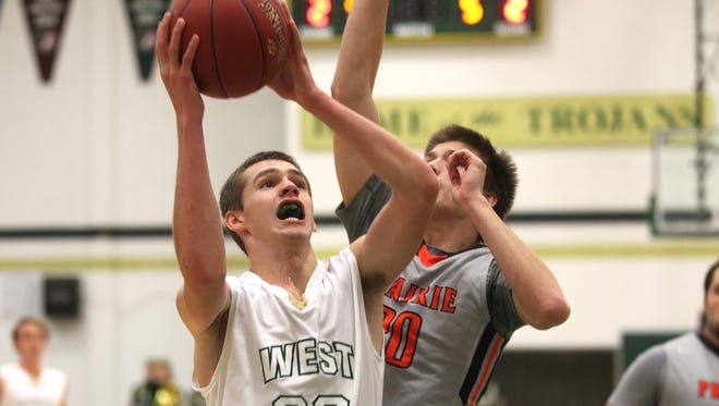 West High's Tanner Lohaus drives to the hoop during the Trojans' game against Cedar Rapids Prairie on Friday.