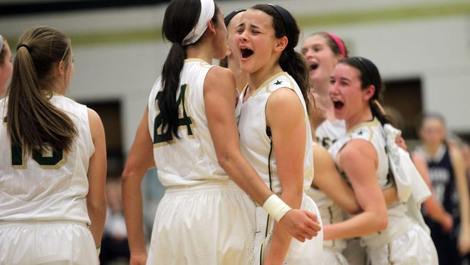 West High senior Mikaela Morgan, left, celebrates with freshman Rachael Saunders following the Women of Troy's Class 5A regional final against Pleasant Valley on Tuesday, Feb. 24, 2015. West High won, 45-27, to advance to the state tournament.
