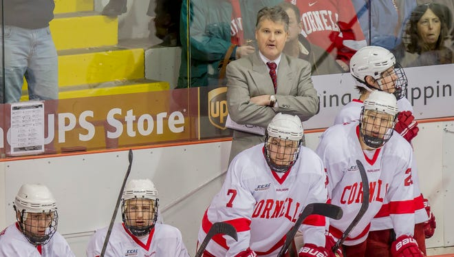 Cornell men's hockey coach Mike Schafer, pictured behind the bench during a game in 2014, takes his team to Madison Square Garden to take on Boston University on Saturday. Cornell has gone 3-5-1 against BU during Schafer's tenure.