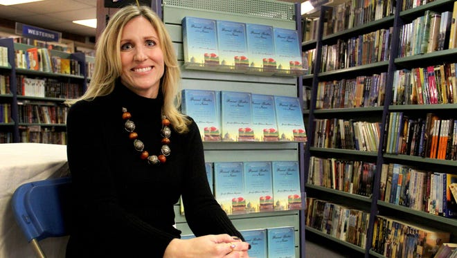 """Author Jennifer Hillman-Magnuson starts her book tour at the Book Bin in downtown Salem. Her travel memoir, """"Peanut Butter and Naan,"""" chronicles the seven months that she, her husband and five children lived in India."""
