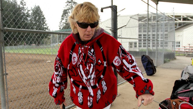 Softball coach Nancy Aiken leads a practice at Santiam High School in Mill City, Ore., on Wednesday, April 1, 2015.