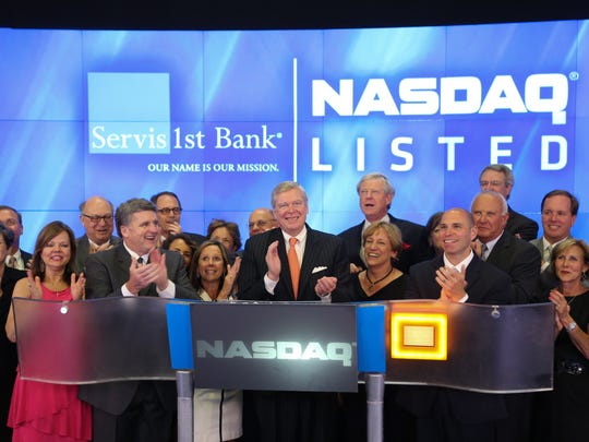 ServisFirst Bank executives ring the closing bell for the NASDAQ on June 26, 2014.