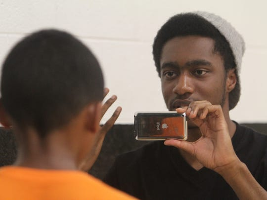 Taub Academy students shoot their story during a soccer camp which was held at RIT in Henrietta on July 24,2014.  Akil King, 18, of Greece interviews Chase Alexandre, 9, of Brighton.