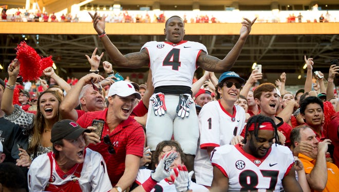 Georgia wide receiver Mecole Hardman (4) celebrates with fans after defeating Tennessee during the Tennessee Volunteers vs. Georgia Bulldogs game at Neyland Stadium in Knoxville, Tennessee on Saturday, September 30, 2017.