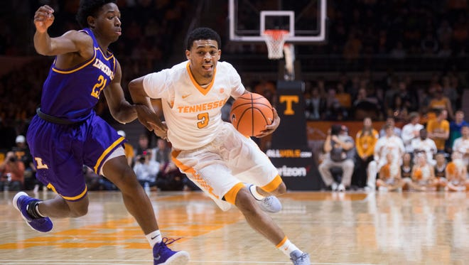 Tennessee guard James Daniel III (3) charges towards the basket as Lipscomb guard Kenny Cooper (21) defends him during a game against Lipscomb at Thompson-Boling Arena in Knoxville, Tenn. Saturday, Dec. 9, 2017.