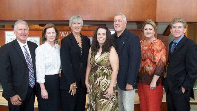 Amber Dugger of Smyrna recently received the Smyrna Rotary StoneCrest Medical Nursing Scholarship through the Motlow College Foundation. Attending the presentaton, from left, were John Black, president-elect of the Smyrna Rotary Club; Cheryl Hyland, interim assistant vice president of student affairs; Jan Rogers, director of advancement at Motlow; Dugger; Jerome Dempsey, president of Smyrna Rotary; Lisa McMahon, secretary of Smyrna Rotary; and Anthony Kinkel, Motlow College president.