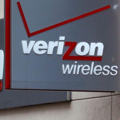 A sign hangs outside a Verizon Wireless retail store