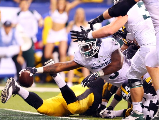 LJ Scott is responsible for one of the great moments in MSU football history – his spinning, lunging, reaching touchdown to beat Iowa in the 2015 Big Ten championship, which sent the Spartans to the College Football Playoff.