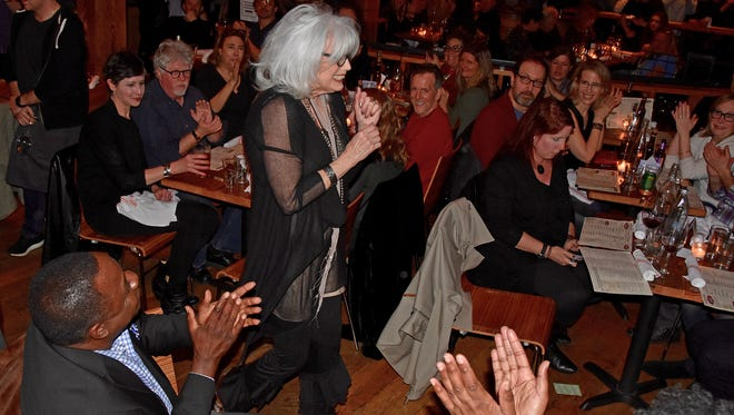 MTSU President Sidney A. McPhee, lower left, applauds Emmylou Harris as she arrives for the Americana Music Association tribute concert in her honor Saturday night at New York's City Winery. MTSU partnered with the association to present the event.