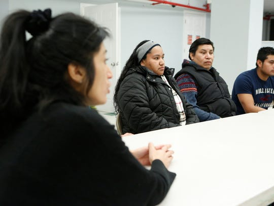 Janet Rolon, left, co-executive director of Community Resource Center in Mamaroneck translates comments from local resident, Marta Caraballo, center, on Wednesday, February 15, 2017. The center and local residents helped draft a proposed bill allowing undocumented immigrants in NY State to get a drivers license which has been introduced in the NY Senate.