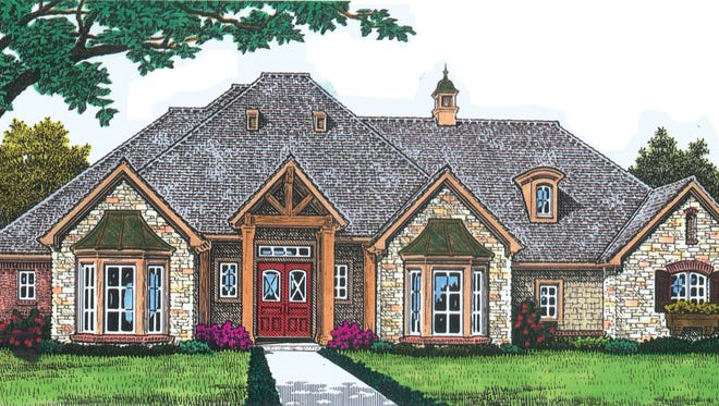 Twin bay windows and a stunning truss will draw all eyes to this beautiful home.