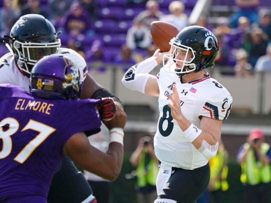 Cincinnati Bearcats quarterback Hayden Moore (8) throws the ball against the East Carolina Pirates  during the first quarter at Dowdy-Ficklen Stadium. Mandatory