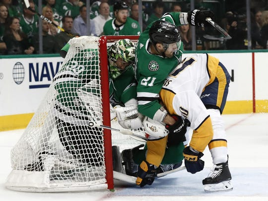 Dallas Stars goaltender Ben Bishop (30) is pushed into the net by Ben Lovejoy (21) who helps defend against a pressure from Nashville Predators' Colton Sissons (10) in the second period of Game 6.