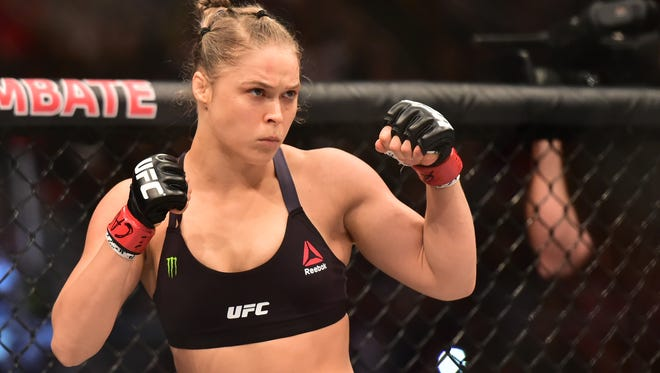Ronda Rousey details in her autobiography how she assaulted an unnamed ex-boyfriend.