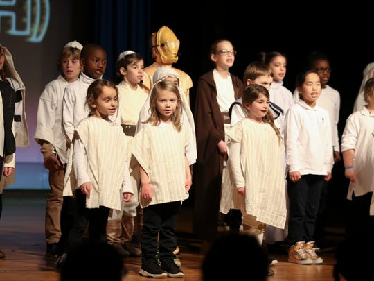 "Albert Einstein Academy students sing an introduction to the Hanukkah/Star Wars mashup production ""Star (of Judah) Wars"" at the Siegel JCC Thursday."