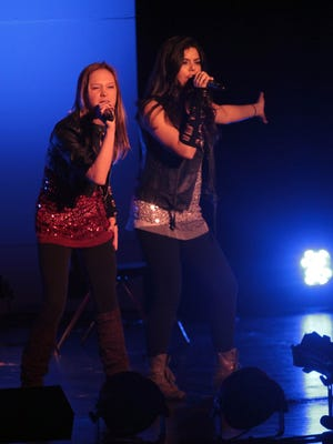 From left, Emma Clarke, 2011 Junior Yonkers Idol winner, and Lynette Innabi, Yonkers Idol winner, perform during the Yonkers Idol at the Lincoln High School Auditorium in Yonkers on March 24. The city hosted the third round of the annual competition where the winners will hold the title for a year and win 00, courtesy of Untermyer Performing Arts Council Teresa Fund. The title provides performance opportunities for various Yonkers ceremonies and events.  Carucha L. Meuse/ The Journal News From left, Emma Clarke, 2011 Junior Yonkers Idol winner and Lynette Innabi Yonkers Idol winner perform during the Yonkers Idol at the Lincoln High School Auditorium in Yonkers March 24, 2012. The City hosted the third round of the annual competition where the winners will hold the title for a year and win $1000, courtesy of Untermyer Performing Arts Council Teresa Fund. The title provides performance opportunities for various City of Yonkers ceremonies and events. (Carucha L. Meuse / The Journal News )